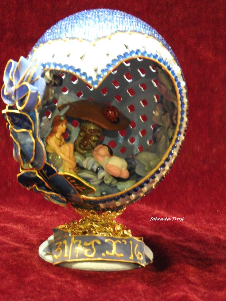 Ostrich Egg, lattice carved, Polymer clay flower & bow & Mushroom. Inside flower are 'sospeso trasparente' Baby in polymer clay.  Fairy figurine