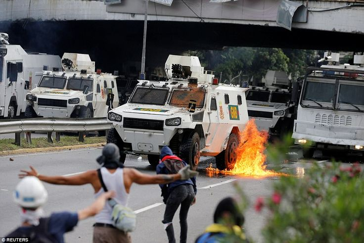 Scores of riot police were deployed on the streets of Caracas yesterday in an attempt to head-off the violence, but clashes continued to rock the streets after weeks of deadly protests
