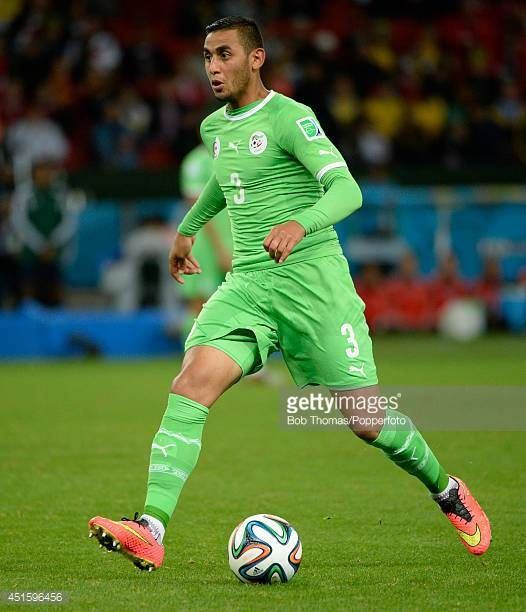 Faouzi Ghoulam in action for Algeria during the 2014 FIFA World Cup Brazil Round of 16 match between Germany and Algeria at Estadio BeiraRio on June...