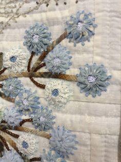 Yo yo flowers with embroidery. Tokyo International Quilt Festival 2013.  Photo byannelize