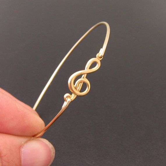 Hey, I found this really awesome Etsy listing at http://www.etsy.com/listing/108399336/music-bracelet-music-jewelry-treble-clef