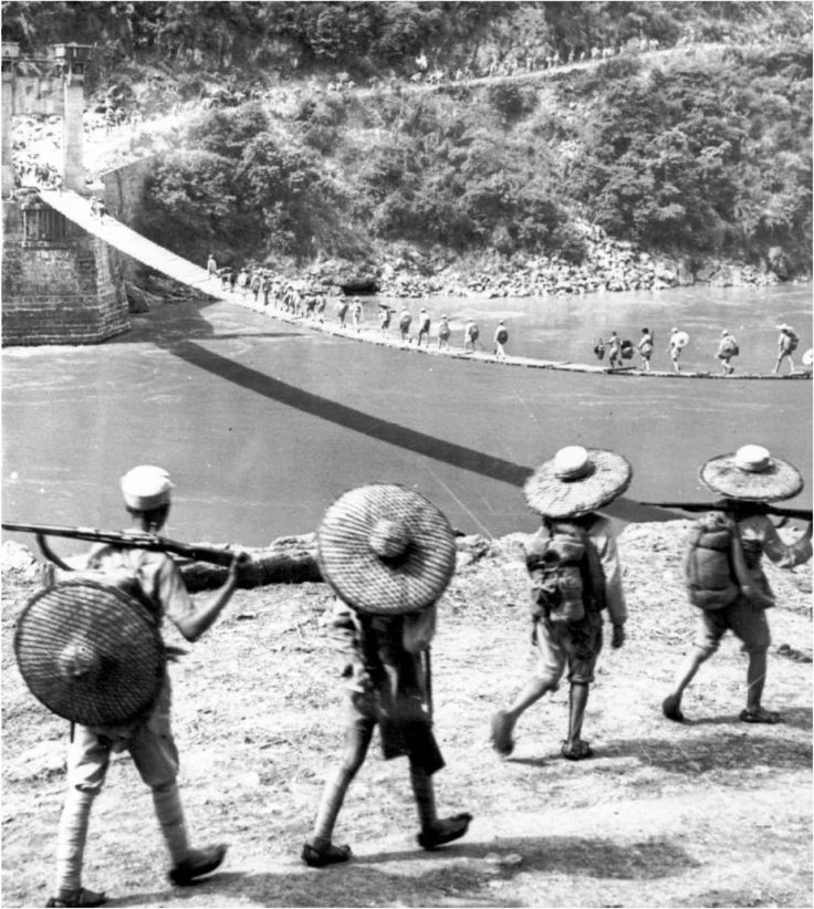 CROSSING THE SALWEEN RIVER, July 1944. The temporary suspension bridge was built to replace the permanent bridge here which was blown up in 1942 by the Chinese as a defense measure against the Japanese advance. While Allied forces advanced on Myitkyina, Chinese troops crossed the Salween River from the east. The two forces met at Teng-chung in September 1944, establishing the first thin hold in northern Burma.