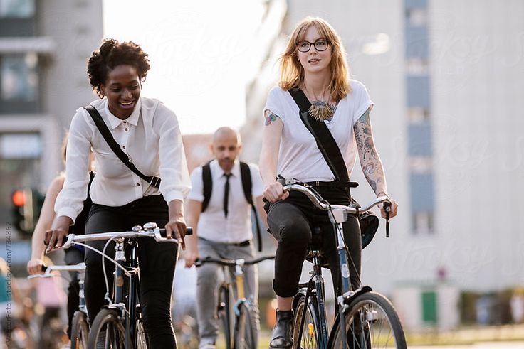 Three Office workers Commuting on Bicycles to work