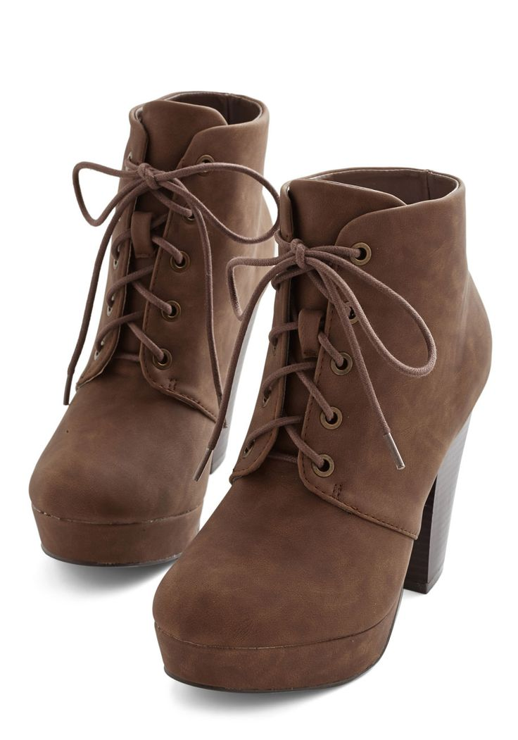 Come Haute on Top Bootie. Youre to reign as you strut alongside the fiercest of fashionistas in these mocha-brown platform booties! #brown #modcloth