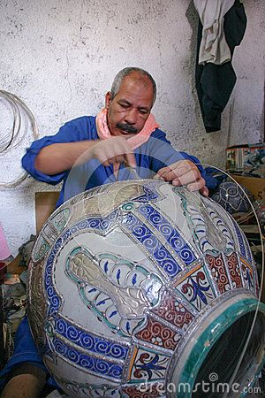 Potter creates a pot in his workshop in Fez - Morocco