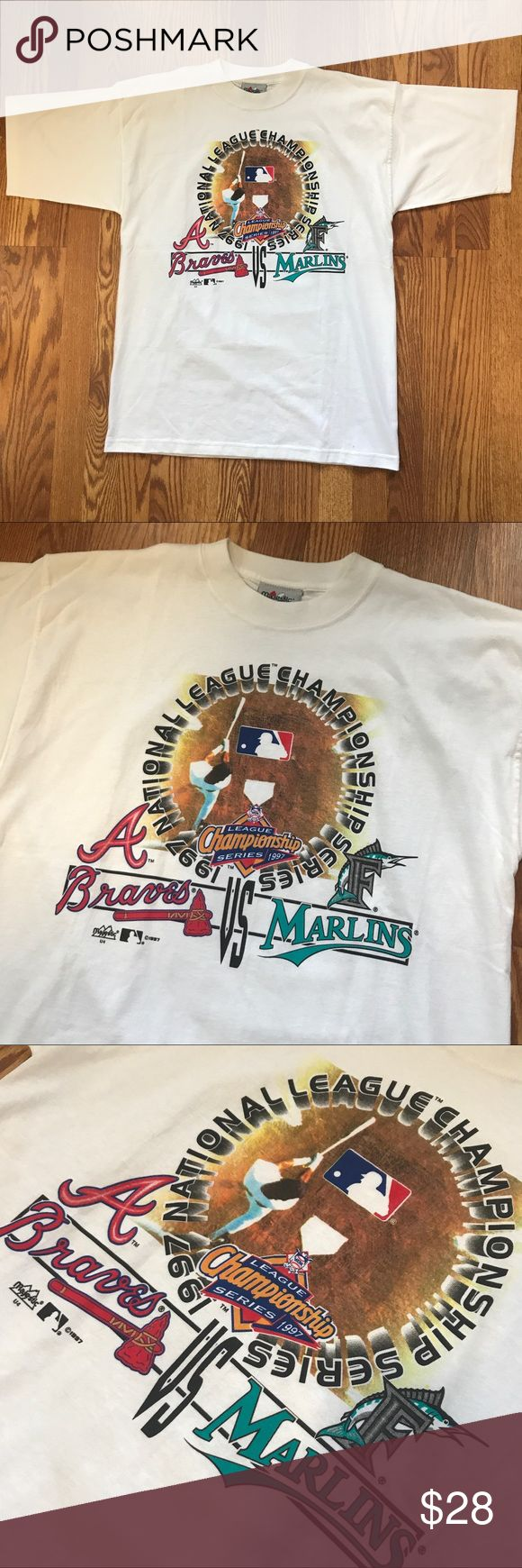 Vtg 1997 national league champs braves vs marlins Vintage 1997 National league Championship Braves Vs Marlins graphic T Shirt. Awesome era piece. Very clean, no notable imperfections.  Condition: 9+/10 Color: White  Size: Large    I ship out fast with tracking! Measurements upon request. Subject to tiny imperfections. Majestic Shirts Tees - Short Sleeve