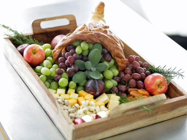 Make an edible centerpiece for your Thanksgiving table using refrigerated bread dough, aluminum foil and a single egg. Fill with sweet and savory nibbles for an impressive centerpiece that'll keep your guests happily munching while they wait for dinner to begin.
