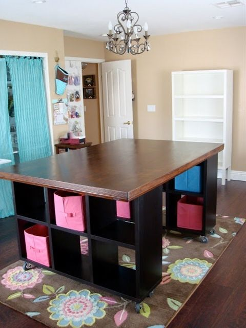 clever how she made the large craft table with 2 cabinets, and her own top