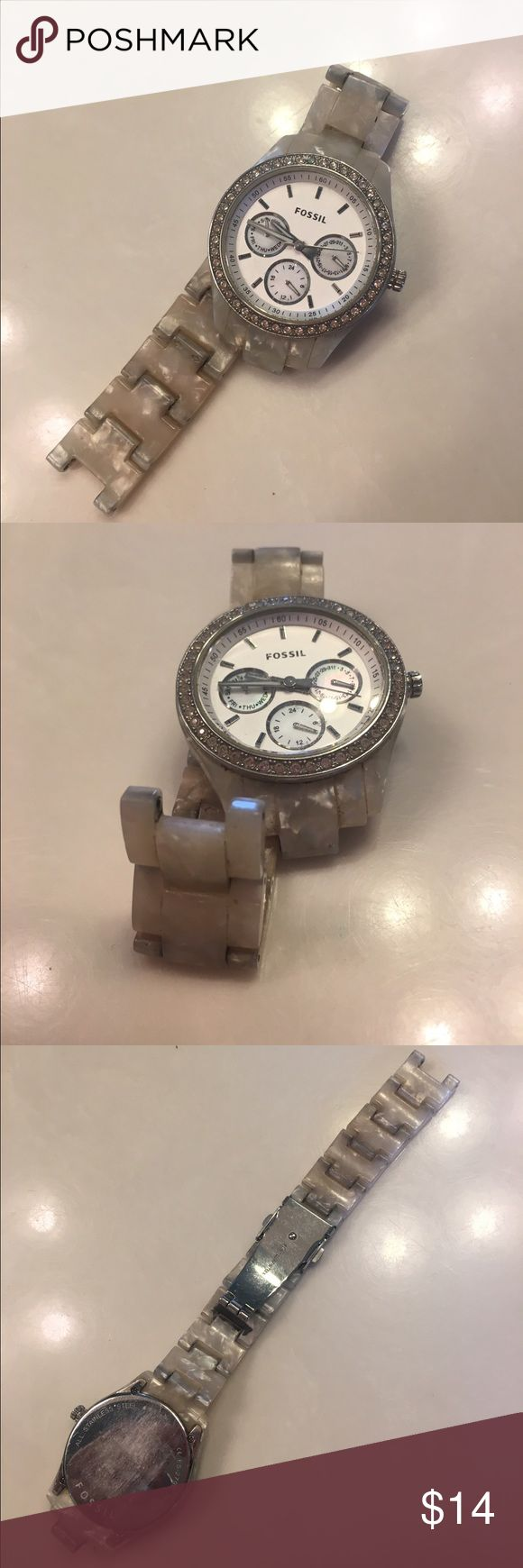 Fossil watch needs battery/needle Pearl off-white Fossil watch. One of the needles needs replaced as shown (I have had Dillards do this for me) and it needs a new battery Fossil Jewelry