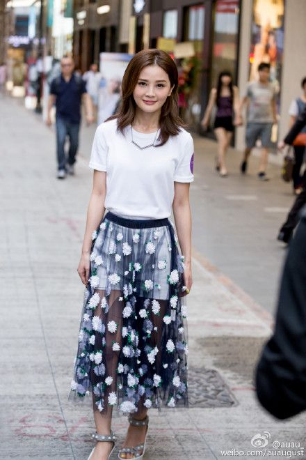 HK singer Charlene Choi in Michael Kors floral sheer midi skirt. I can't stop paying attention to her heels! Ultimate summer chic look.