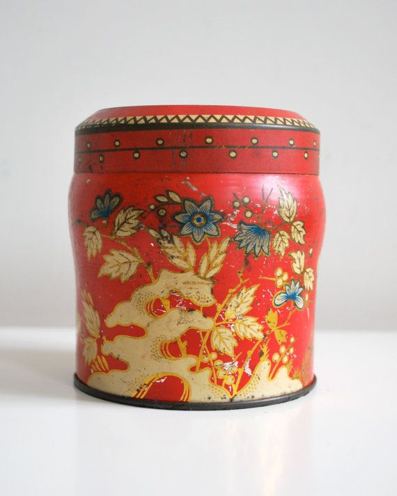 Vintage red tin tea caddy in red and gold, via Etsy.