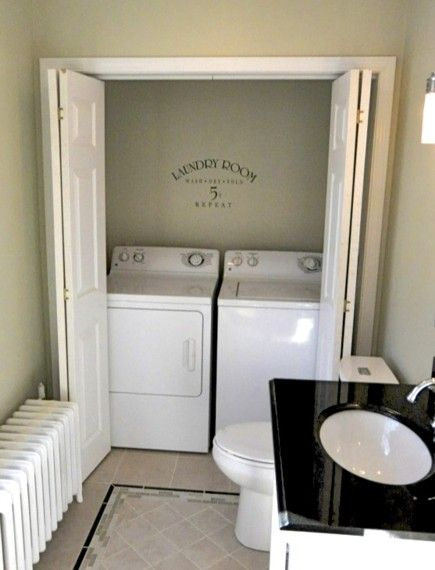 laundry inside a bathroom. Compact space living, with a little tweaking of shelving an d wider doors this could turn out really nice.