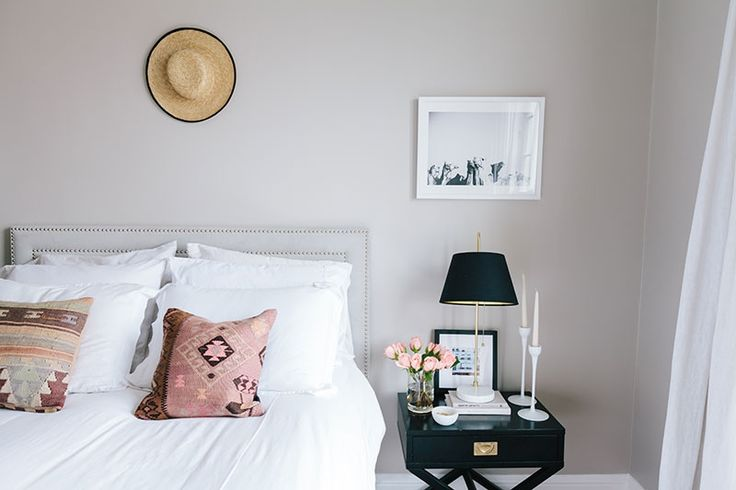 A tiny apartment still manages to pull off 'luxe chic' by keeping it neutral with flashes of gold