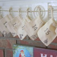 Hanging Advent Calendar $29.99 ~ Muslin, Rope, & Handcrafted Design come together for a rustic and cute way to count down to Santa's arrival.  This rustic chic Advent Calendar is a lovely way to count and celebrate the days in anticipation of Christmas. Out of all possible Christmas décor, the advent calendar is the most fun and creative decoration to display. Especially if you are a lover of tiny trinkets and chocolates!