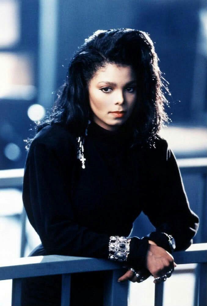 Janet Jackson 90s fashion icon. She looks so much like Michael :)