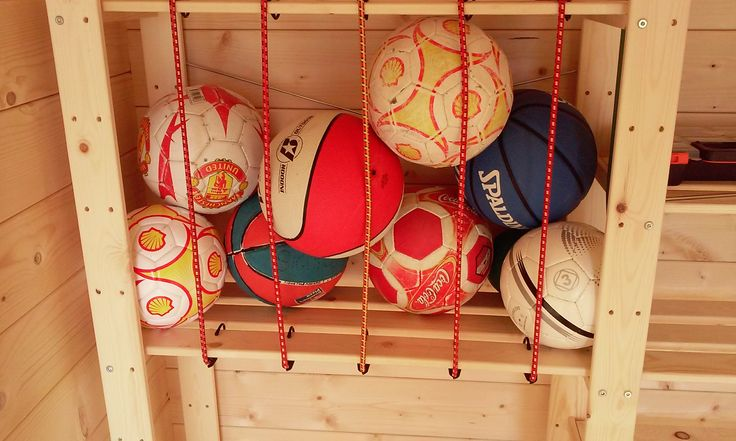 "Ball storage solution in a ""Hejne"" shelf from Ikea"