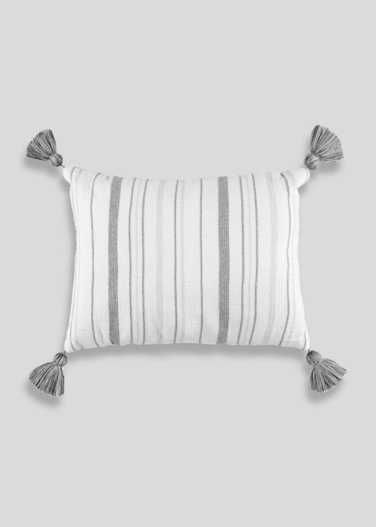 100% cotton stripe cushion in cream with grey stripe detail and features a tassel edge for added detail. Matching throw available.