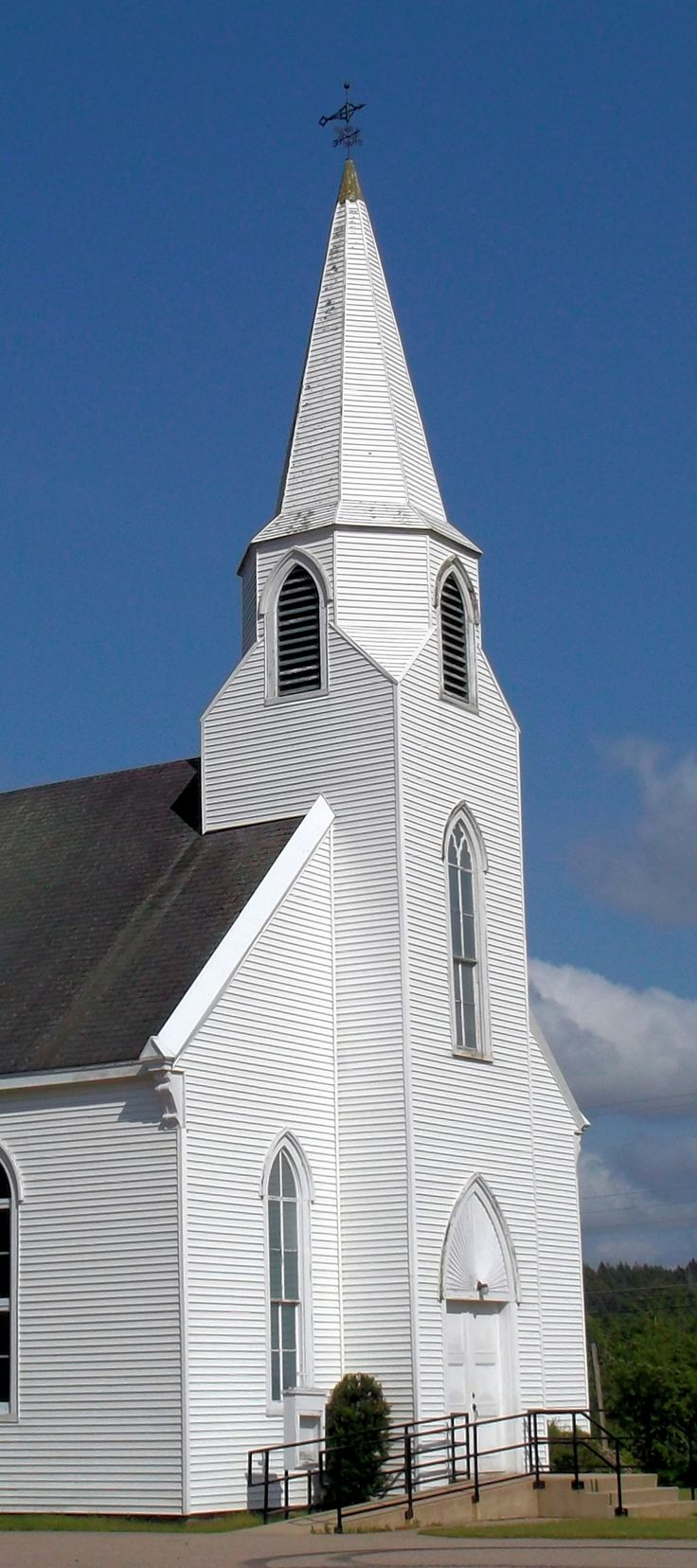 """Small Country Church 3:  steeple of an old white clapboard Baptist church in the Annapolis Valley of Nova Scotia, against a bright blue sky,  Image size 1200 x 2700px (300ppi); prints at 4 x 9""""."""