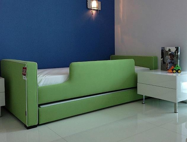Green Dorma Bed with White piping and Toddler rail. Photo courtesy of Genius Jones and shared by interior designer Carlos Matta
