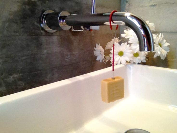 SoapUp holds the soap above the sink, so it is always available!