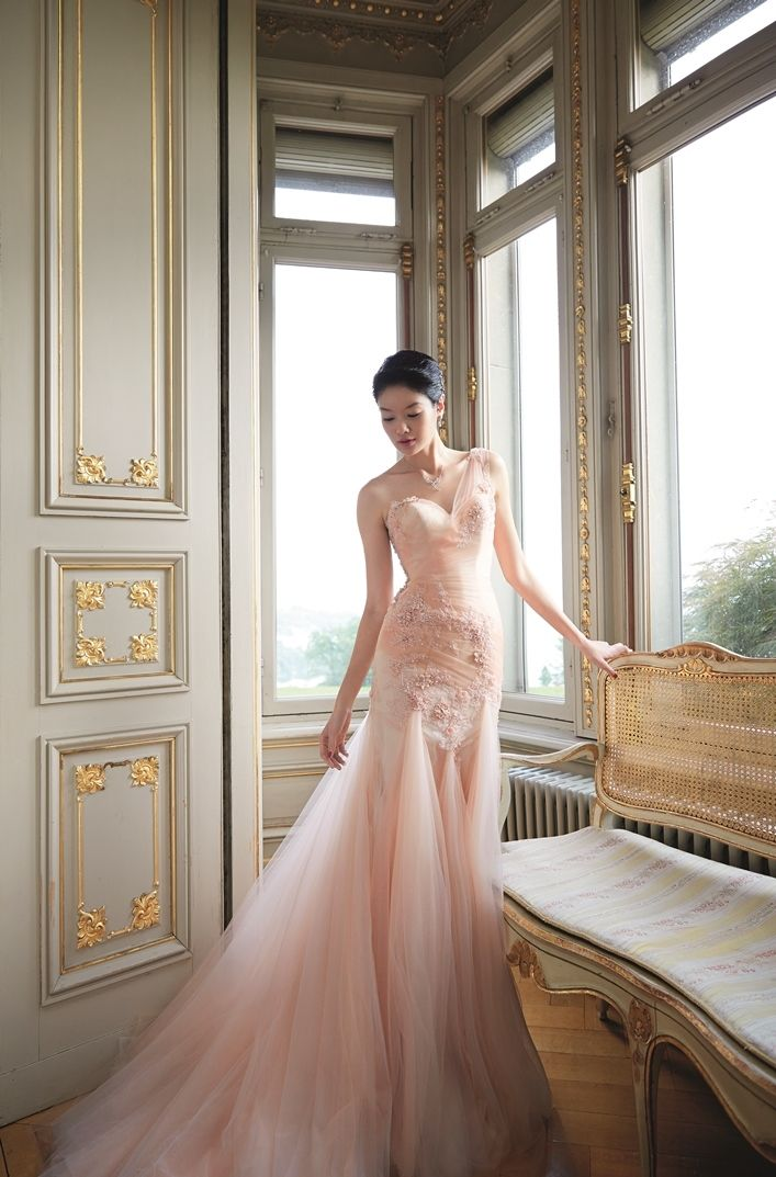 Bridal shoot with peach color dress | Inspiring post by Bridestory.com, everyone should read about Model-actress Sheila Sim does her first bridal shoot in Lucerne, Switzerland on http://www.bridestory.com.sg/blog/model-actress-sheila-sim-does-her-first-bridal-shoot-in-lucerne-switzerland