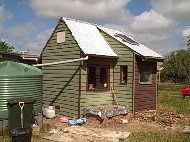 That rain barrel! Nice. David Bell's 100 sf house, 100sq ft house in Birchip, Victoria, Australia.