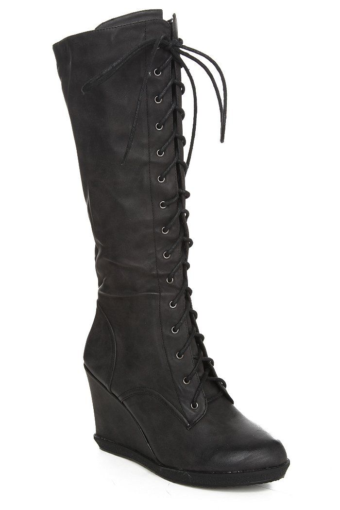 basically what I've wanted for over a year: knee-high lace up black wedge boots.