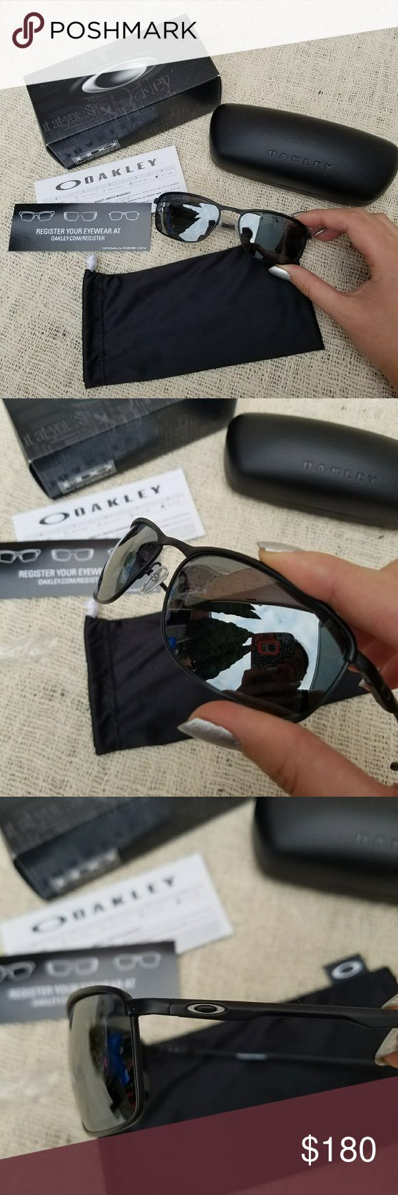 """NWB Oakley Conductor 8 Polarized Sunglasses New with box, hinged case, large drawstring microbag, and registration info! Oakley Conductor 8 sunglasses with polarized lenses. Black frames, black iridium lens. """"Integrated spring hinges, patented Unobtainium® earsocks and air-filled silicone nose pads bring a comfortably secure Three-Point Fit to a lightweight C-5™ alloy design.""""  Brand new never used, my mom got them for my BF but he's a dedicated Ray-Bans guy! Offers welcome through offer…"""