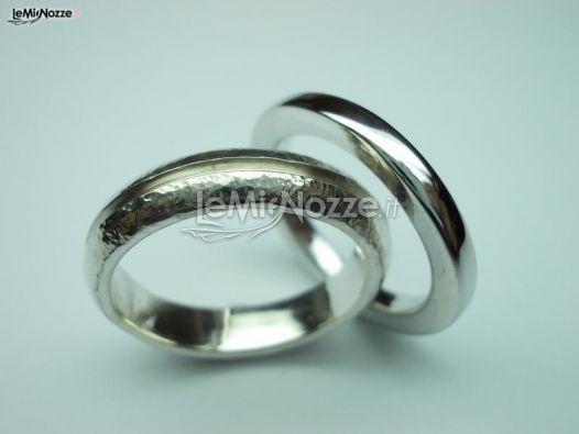 http://www.lemienozze.it/operatori-matrimonio/gioielli/fedi-personalizzate-roma/media/foto/10  Fedi nuziali moderne