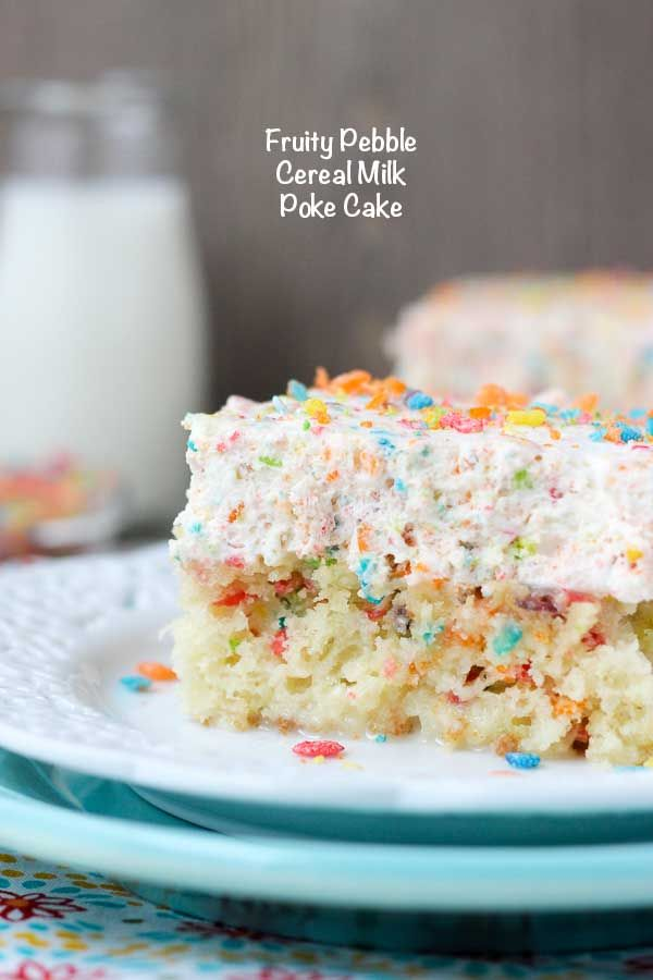 If you love Fruity Pebbles, this poke cake is for you! This is a Fruity Pebble filled vanilla cake, soaked in sweetened condensed milk and topped with a Fruity Pebble Whipped Cream. It's a cereal milk inspired poke cake! from @beyondfrosting