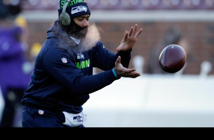 Seahawks Vikings Football The temperature was like in the Arctic!  -6 to Zero degrees! Seattle Seahawks quarterback Russell Wilson (3) warms up before an NFL wild-card football game against the Minnesota Vikings, Sunday, Jan. 10, 2016, in Minneapolis. (AP Photo/Nam Y. Huh)