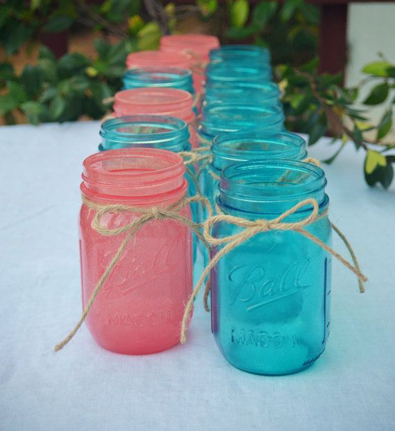 Center pieces? Not necessarily in these colors but I like the idea of it.  Stained Mason Jars In Your Choice of Colors - Set of 12 on Etsy, $60.00
