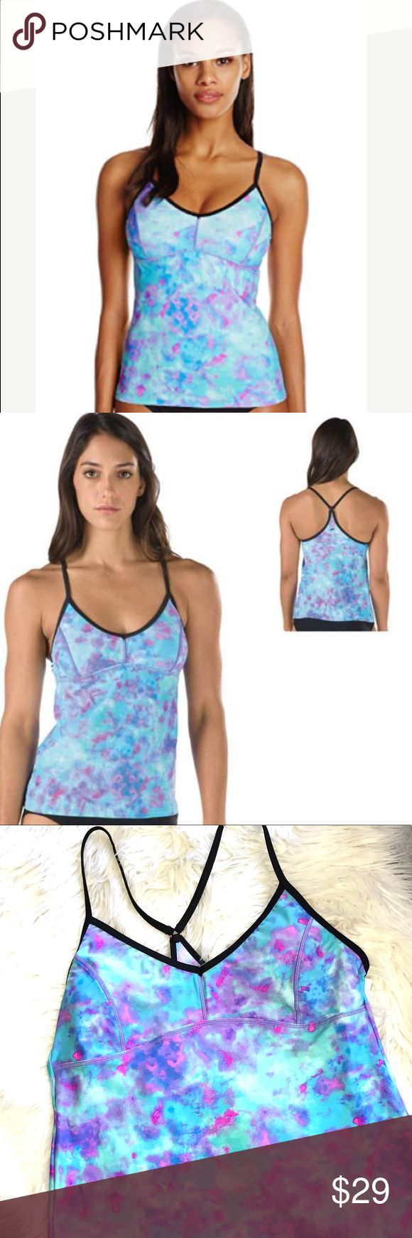 NWT Speedo Aqua Pink Purple Strappy Tankini New with tags watercolor print Tankini Swim Top in vibrant shades of Aqua Turquoise blue, pink & purple.   Black straps.  Lined and lightly padded bust.   Size Large.  Nylon/spandex blend. Speedo Swim