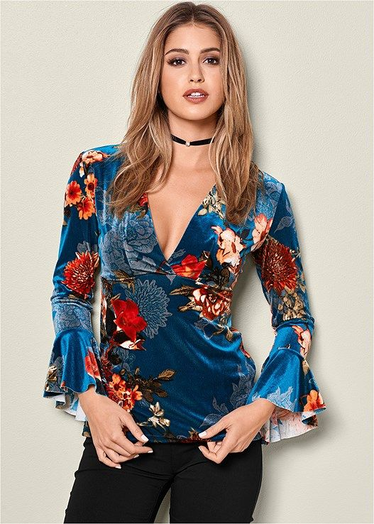 Spice up your fall wardrobe with our Printed Velvet V-Neck Top!