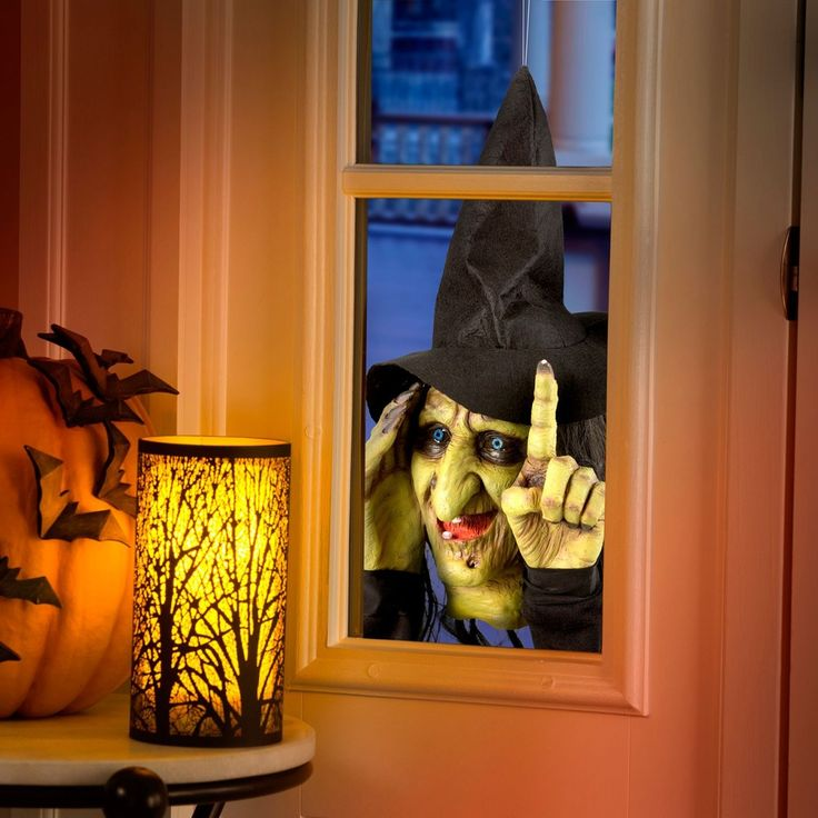 add this creepy halloween decoration to your windows to give family and friends a fright