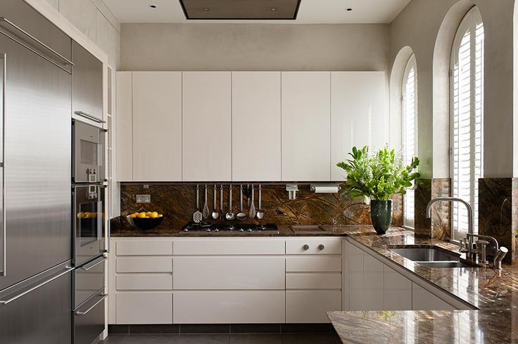 White Handless | Candi Kitchens  Timeless look that can be made look different with natural stone.