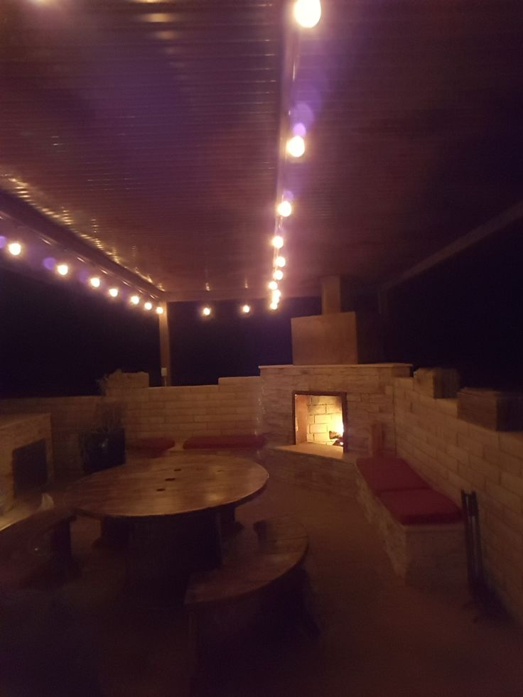 Great party after the beautiful restoration of this DIY Outdoor Fireplace.  #diy #outdoorlife #outdoors #outdoorliving #outdoorfireplace #masonry #landscape #fireplace #kitchen #outdoorkitchen #outdoorcooking #grilling #backyardideas #backyardflare #pizzaoven #pizza #fireplace