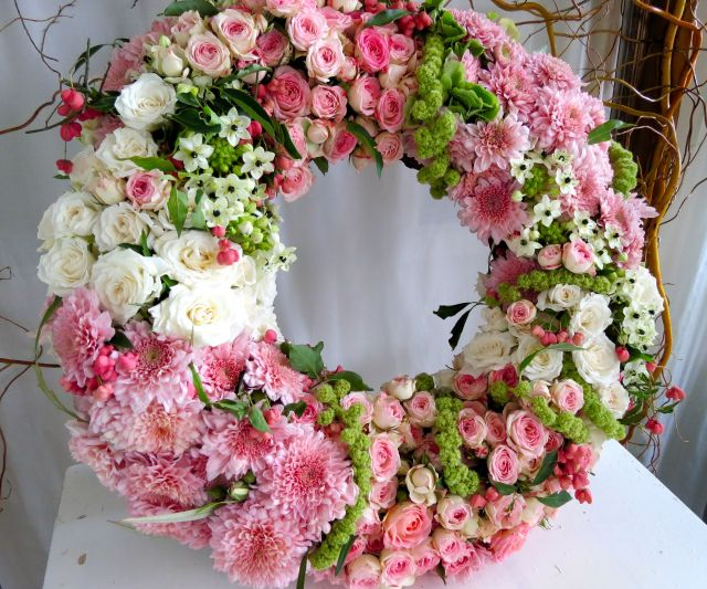 Floral Wreath - a mixture of spray roses, chrysanthemums, ornithogalum (also known as chinch) and a few stems of hanging amaranthus
