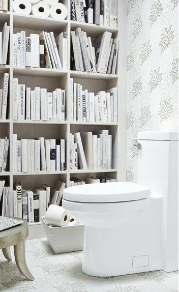 (love the concept of floor-to-ceiling bookshelves in a tiny powder room) DXV by American Standard Bathroom in White by Mary Douglas, Remodelista