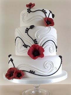 black white and red wedding cake - just think what you could do with other colors. Green vines & bright blue/white morning glories...or even big white moon flowers. Or go super bright with big orange hibiscus flowers on an ocean-blue fondant. So much possibility!