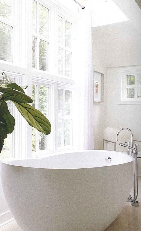 deep soaker tub AtHome Magazine.