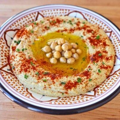 Hummus with tahini - National dish of Palestine. Dip with chickpeas with tahini, olive oil, lemon juice, garlic and salt.