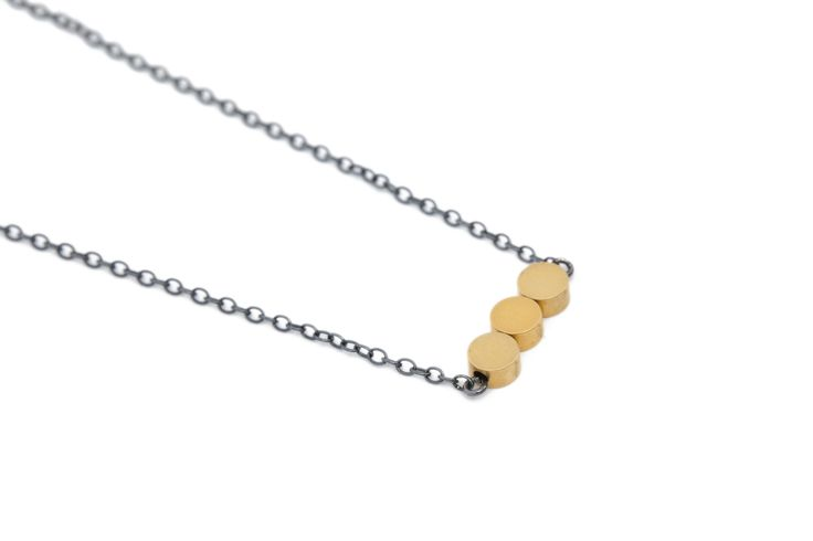 Silver necklace with matte gold beads