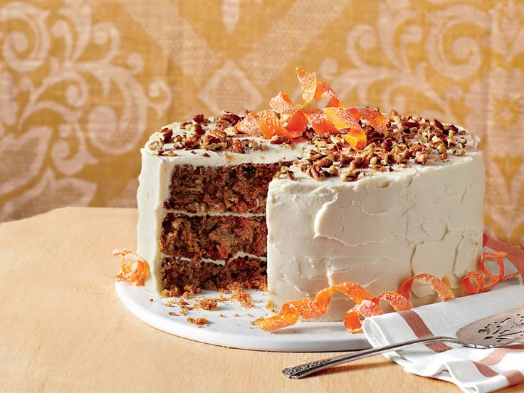 The Ultimate Carrot Cake | Made with grated carrots, pieces of Granny Smith apple, and sweetened coconut, the resulting cake layers are moist, sweet, and soft. And, can we talk about the garnishes on this classic Southern cake recipe? We've frosted this beauty with Brown Sugar-Cream Cheese Frosting, which has just the right amount of creamy sweetness to make guests ask for a second slice. Southern Living