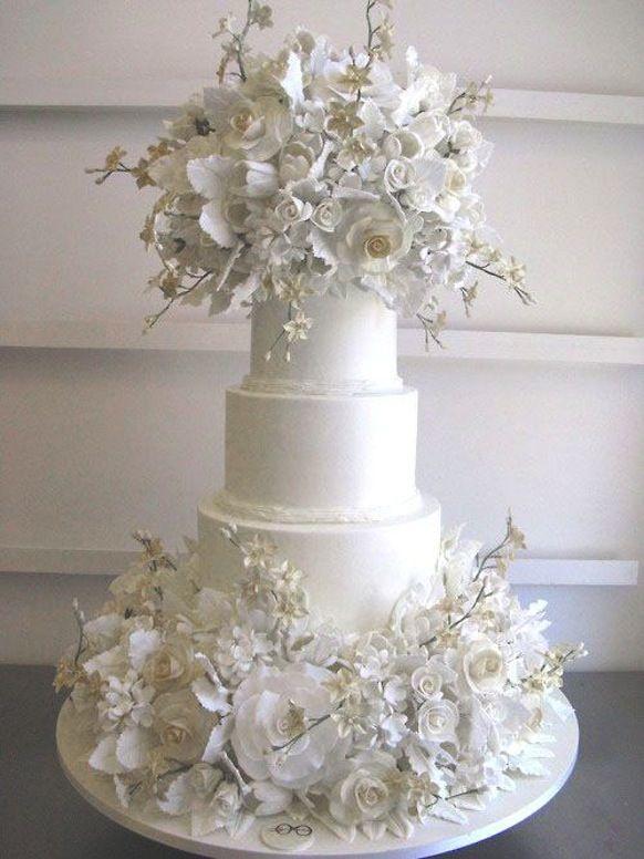 Dramatic White Wedding Cake  courtesy of Sylvia Weinstock via Preston Bailey #whitewedding