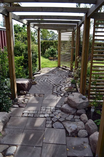 concrete + granite blocks path >>  it's the idea of arbour and slatted gates/panels which interests me..
