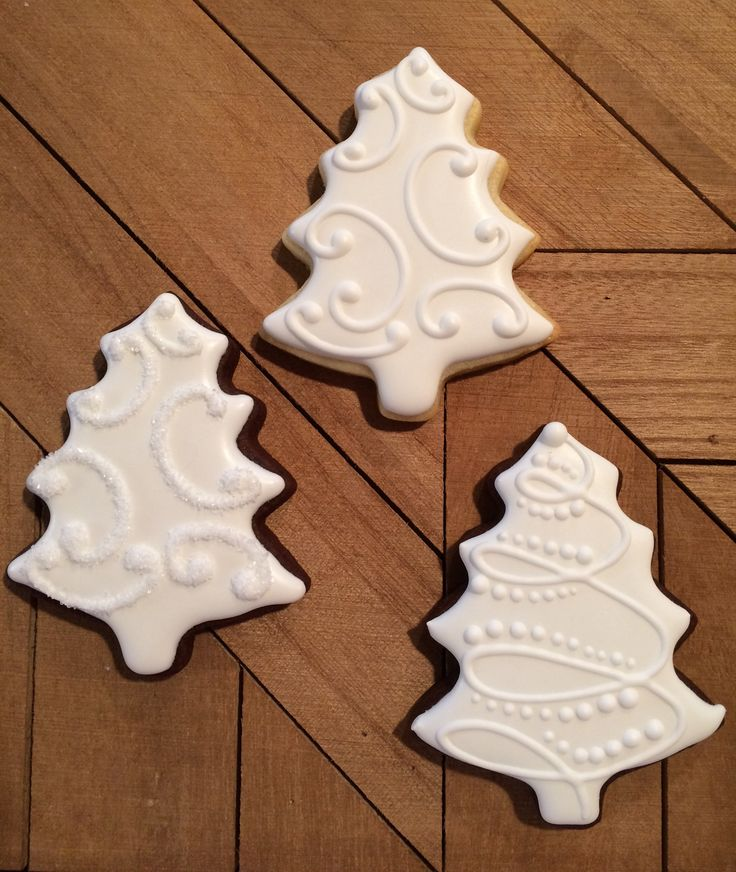 Simple Christmas Tree cookies. Love the bottom right one!
