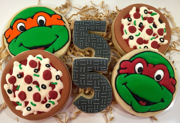 Ninja Turtle (TMNT) sugar cookies by What The Cookie! Confections. Turtle cookie; pizza cookie; sewer lid cookies; boy birthday party