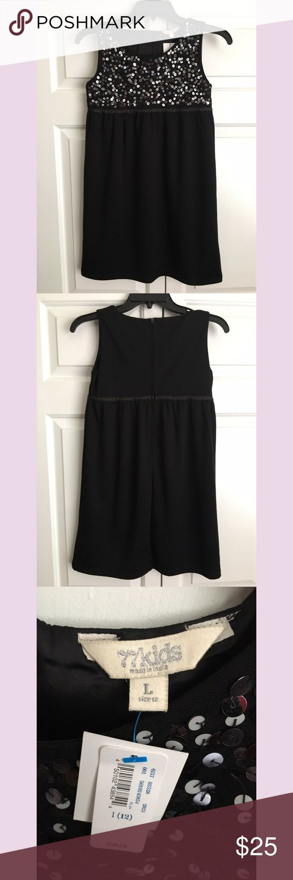 77Kids by American Eagle Girls Sparkly Black Dress Brand new with tags! Hard to find piece! Perfect for special events! Smoke and pet free home. Fully lined with a zipper in the back. Size large or 12. Poly/rayon/spandex blend. No trades.  item location: Bin 2. 77 Kids by American Eagle Dresses Formal