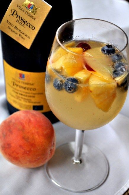 The easiest (and the best) Peach Sangria recipe ever! Fresh peaches gently flavour Prosecco or your favourite sparkling wine.
